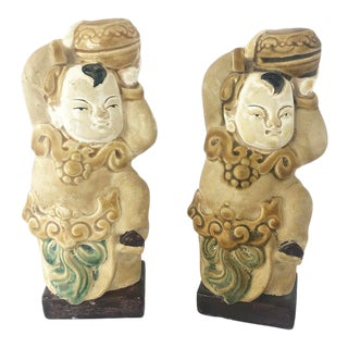 Vintage Pair of Chinoiserie Male Figures Holding Round Boxes For Sale