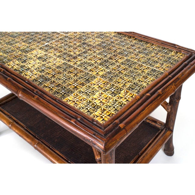 19th century English bamboo rectangular coffee table with a green tile top and a rush covered lower shelf.