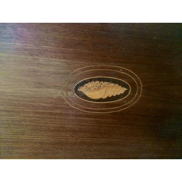 This is an antique English tray from the 1920s. The piece features an inlaid shell medallion in the center and has two...