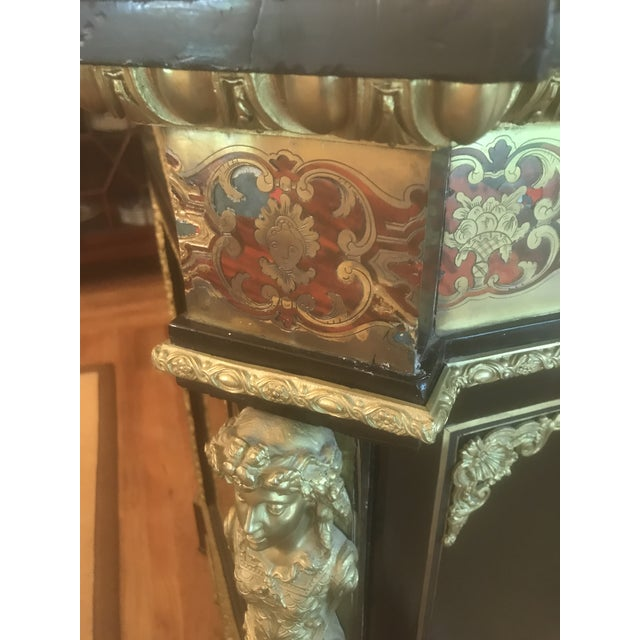 We believe this piece is circa 1850 and is considered of Napoleon III period. Inlaid brass, painted wood, bronze and...