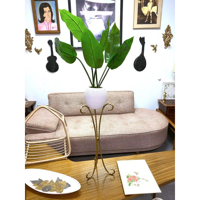 Vintage twisted iron topsy turvy plant stand. Painted gold. Great for indoor or outdoor use.