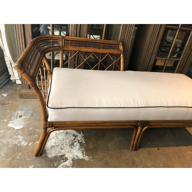 Ultra chic bent bamboo and wicker chaise. New upholstered with off white 100% natural linen and navy blue cotton piping ....