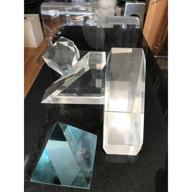 Highly sculptural collection of five Lucite geometric tabletop decorative objects. The collection consists of rectangle...