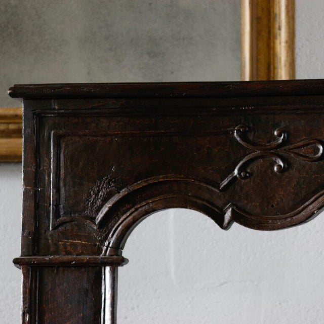 18th Century French Carved Mantle A stylish carved mantle, light in weight and abundant in appearance. Height: 51.5 in...