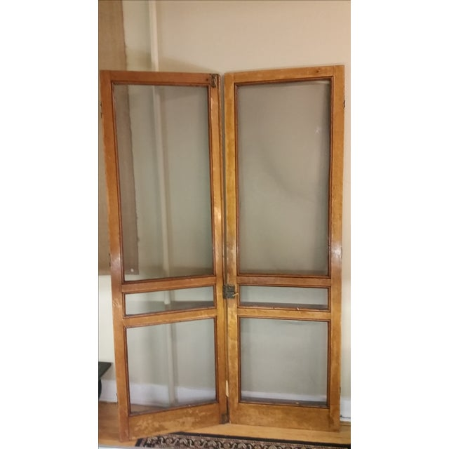 A nice pair of vintage screen doors that were salvaged from a federal style house in Upstate NY. These are tiger oak and...