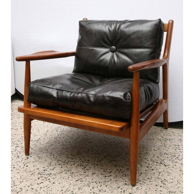 Beautiful sculpted chair by Conant Ball in teak, 1950s, USA.