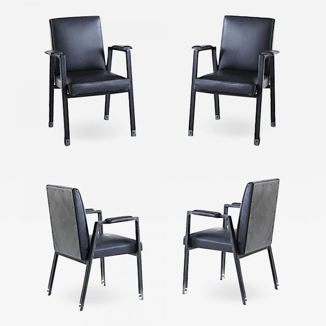Jacques Adnet rare set of 4 black hand stitched leather arm chairs