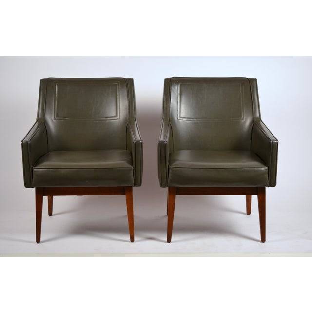 Pair of early California modernist olive green leather upholstered walnut armchairs by Vista of California for Stow Davis....