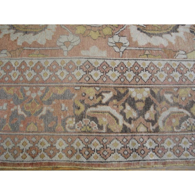 Antique Moud Rug with an ivory background and patterned border.