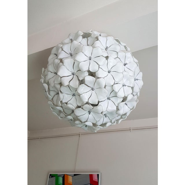 Large flower ball, chrome frame covered by Murano white flowers. By Mazzega, Murano, Italy, 1970s. The chandelier has 10...