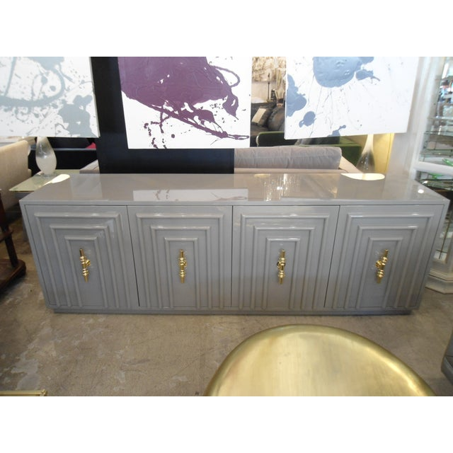 This is a glam, trendy high gloss lacquer sideboard from modshop that will really bring together your decor. It wows...