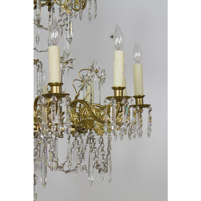 This chandelier was originally made for candles and has been expertly electrified. The entire chandelier is made of thin...