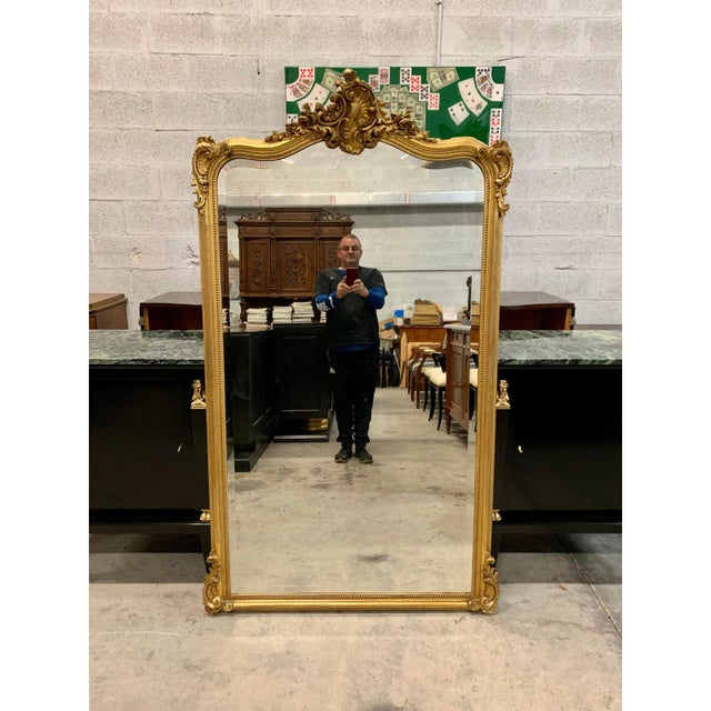 A beautiful antique French mirror Louis XV 1900s giltwood It has the asymmetrical ornamentation typical for Louis XV and...