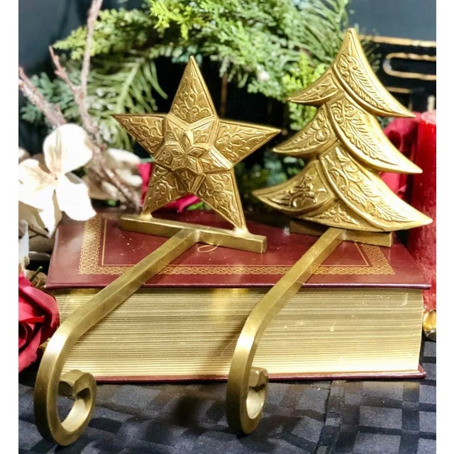 This is for a pair of 2 stocking Christmas hooks for your mantle. These are very unusual in that the brass is antiqued and...