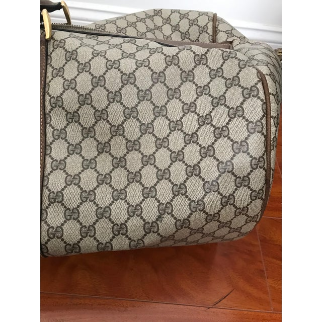 Huge Vintage Gucci Duffel Bag Bag Color: Monogram Canvas Brown Material: Leather Features: -Fully-zippered compartment -2...