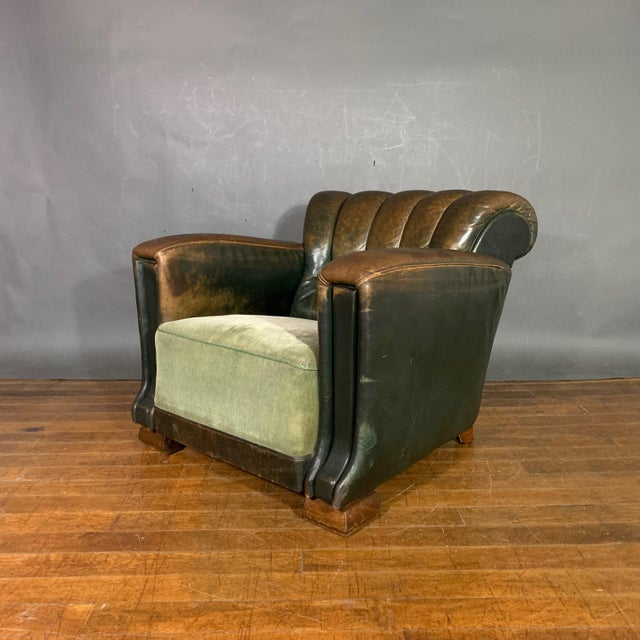 An amazing leather club chair from the Art Deco period that is listed here as French though possibly Scandinavian in...