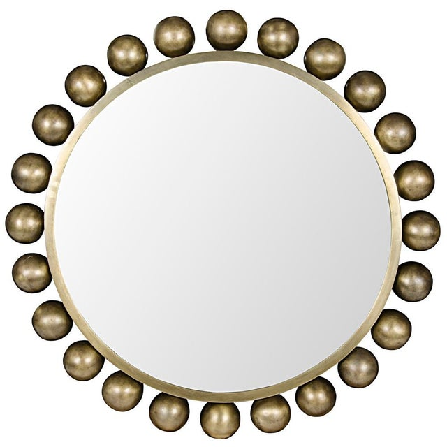 Circles on circles on circles, this round wall mirror reflects the sophistication of the home in which it resides.