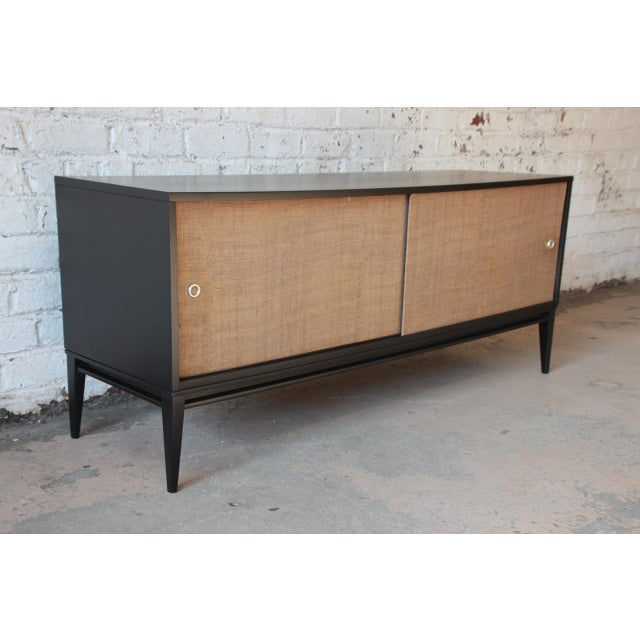 """Offering an exceptional mid-century modern ebonized credenza or record cabinet designed by Paul McCobb for his """"Planner..."""