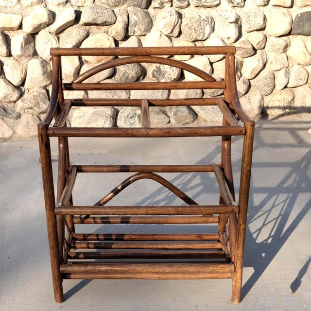 """Rare mid-century modern """"tiki"""" style, 3 tiered, counter height level rattan etagere finished in a chestnut brown wood..."""
