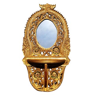 Vintage Indonesian Heavily Carved Gold Wood Dragon Mirror With Shelf For Sale