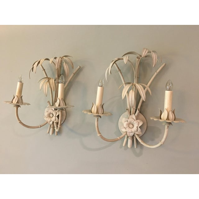Fabulous pair of palm beach style wall sconces. They were wired in the past and with new wiring can be used with candle...