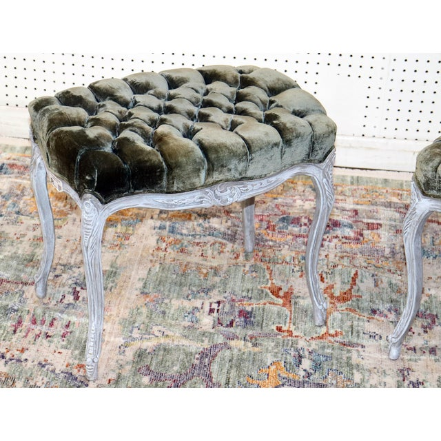 Pair of vintage Louis XV style distressed painted stools with tufted upholstery.