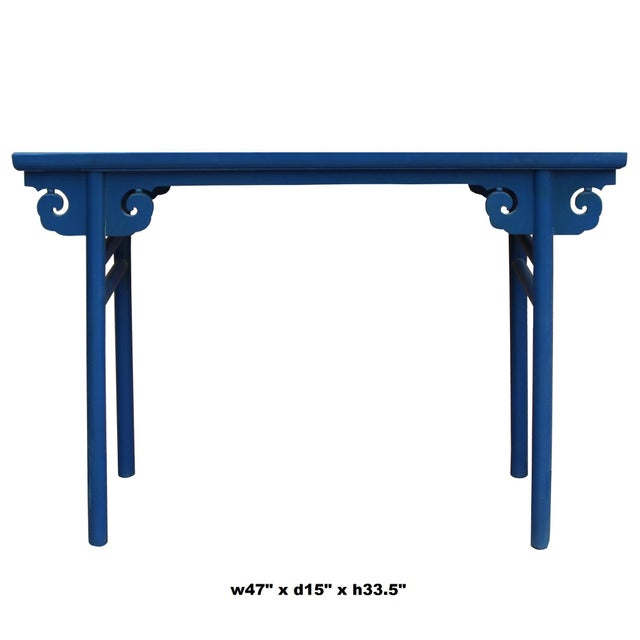 This is a traditional Chinese altar table with scroll pattern apron. The surface is painted with rustic distressed blue...