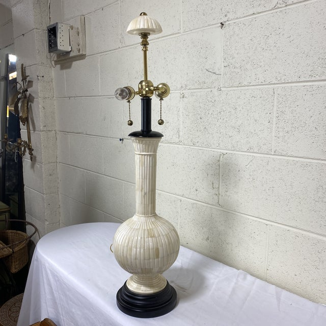 Beautiful vintage bone lamp with dual chain light socket and black painted wood base. Marvelous bone finial with brass...