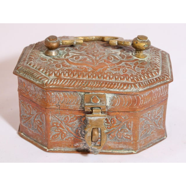 Beautiful handcrafted tinned copper decorative octagonal Anglo-Indian box with with lid, handle and brass latch. The metal...