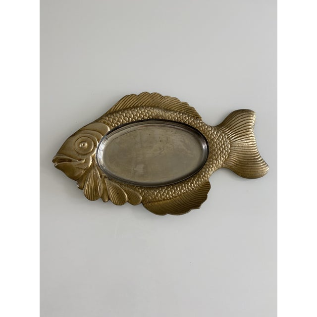 Large brass fish with chrome center. Great size! Use as a catchall, candy dish or ashtray.