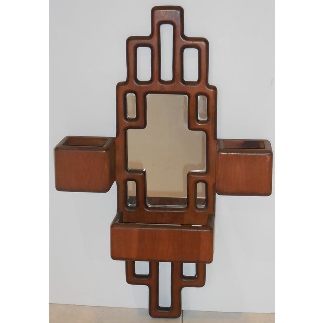 Vintage mirror made of carved wood cubist design with three compartment. Perfect for the hallway, entry or living space!