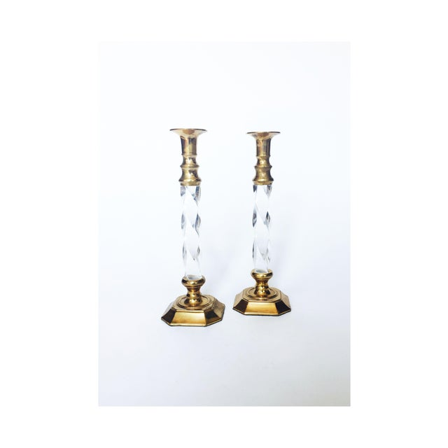An elegant set of 2 large vintage candlestick holders. Each candlestick holder has a brass top and base with a lovely...