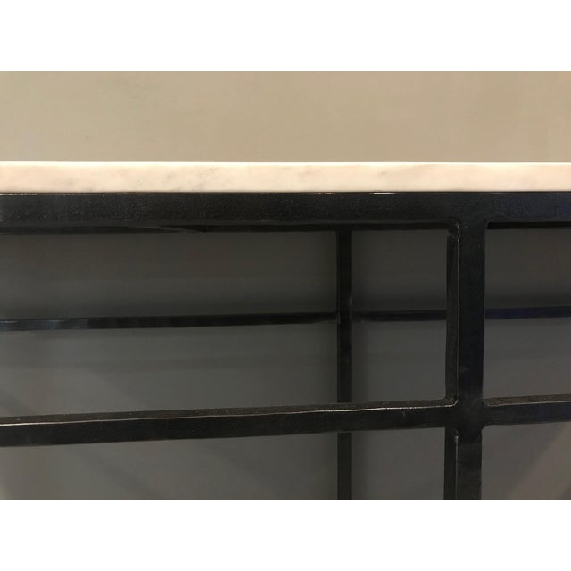 White marble console with forged black iron frame. This piece would look great in an entryway with a vase and decoration...
