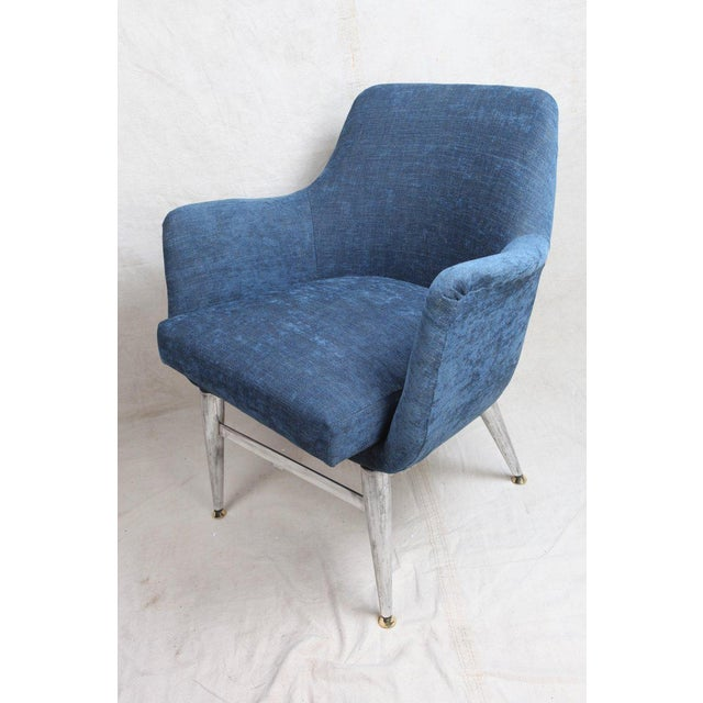 Pair of Mid-Century Modern arm chairs with chrome base and legs, and little brass feet. Reupholstered in a blue silk...