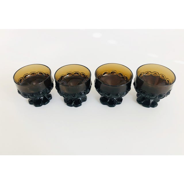 A set of 4 vintage 1970s Tiffin Francisco Madeira coupe glasses in a moody brown color. Nice weight with beautiful...