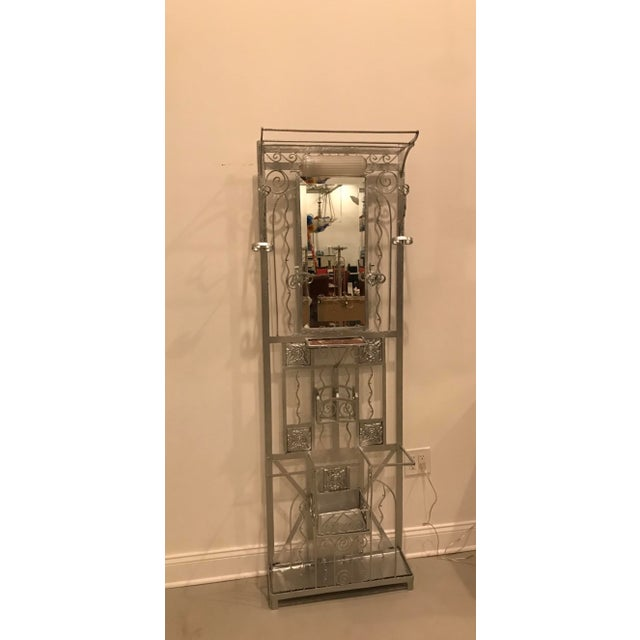 Beautiful French Art Deco hall tree with geometric glass sconce signed by Sabino. Having four coat hangers with two...
