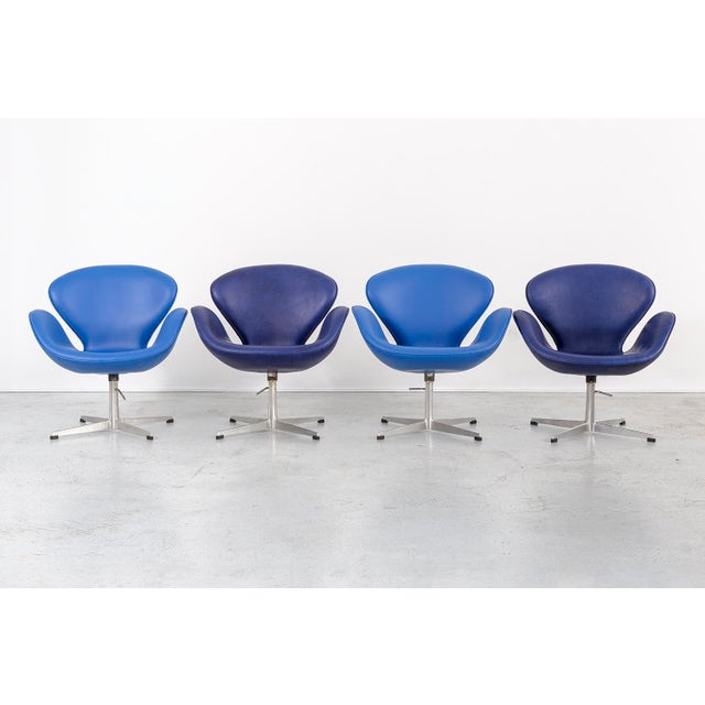 set of four swan chairs designed by Arne Jacobsen for Fritz Hansen Denmark, c 1959 reupholstered in leather + aluminum...