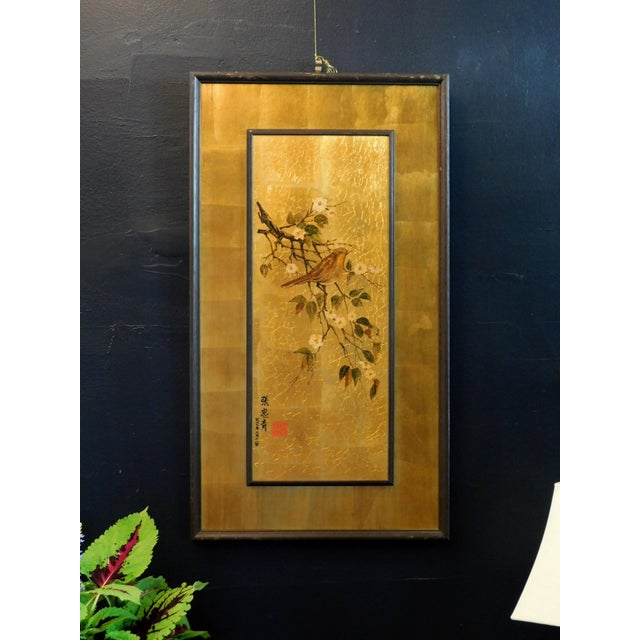 This sweet piece of gold leaf art has beautiful details of a golden bird with a dark brown wood frame. Add a touch of...