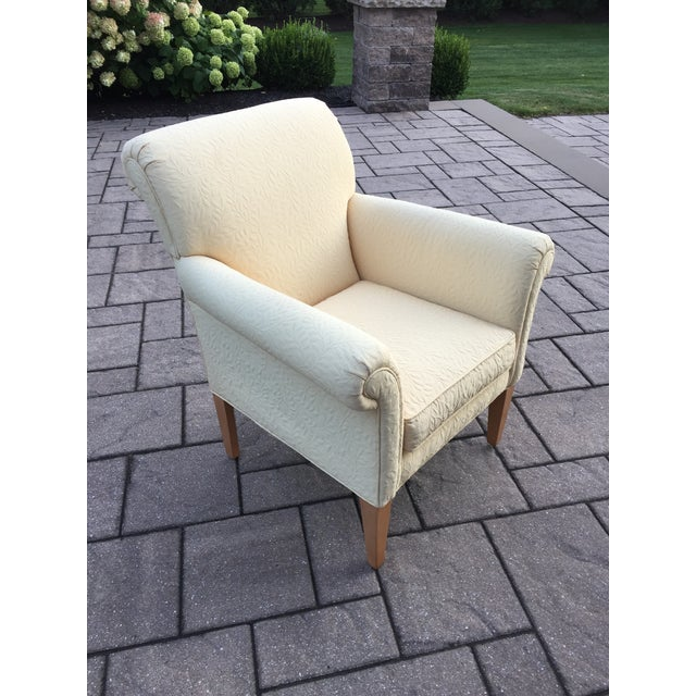 """Ethan Allen """"Emma"""" upholstered yellow accent chair. Chair features a custom embossed leaf pattern fabric in a pale yellow..."""