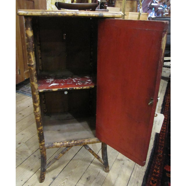 Chinese cabinet with one door - red painted interior. Made in the 1920s.