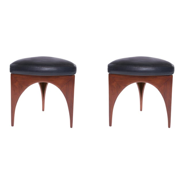 This striking pair of wood and deep navy leather ottomans were handcrafted by Allen Ditson circa early 1960s. These were...