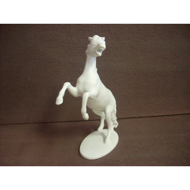 "Rearing horse of fine porcelain made in Germany by Kaiser; the base is inscribed by the artist, ""Bochmann""; a thoughtful..."