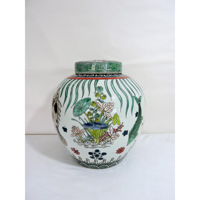 Early 20th Century 'Kangxi' Chinese Pink & White Lotus Flower Porcelain Ginger Jar With Green and Blue Fish For Sale - Image 5 of 10