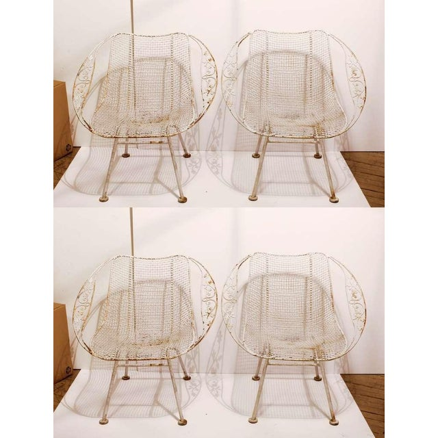 Woodard mesh wrought iron garden armchairs. These would look great in a rose garden or a patio with a fountain.
