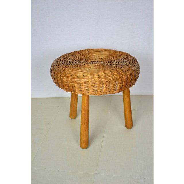 Large mid century modern wicker stool circa 1950. Walnut wooden legs with a wide woven wicker seat. Made in Yugoslavia....