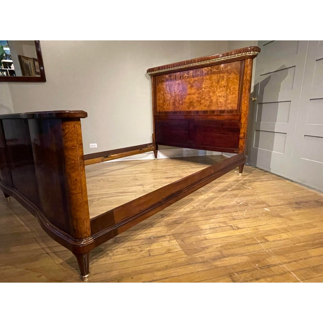 French mahogany and burled walnut bed with paneled ends. Beautiful inlays in satinwood. The well-figured headboard and...