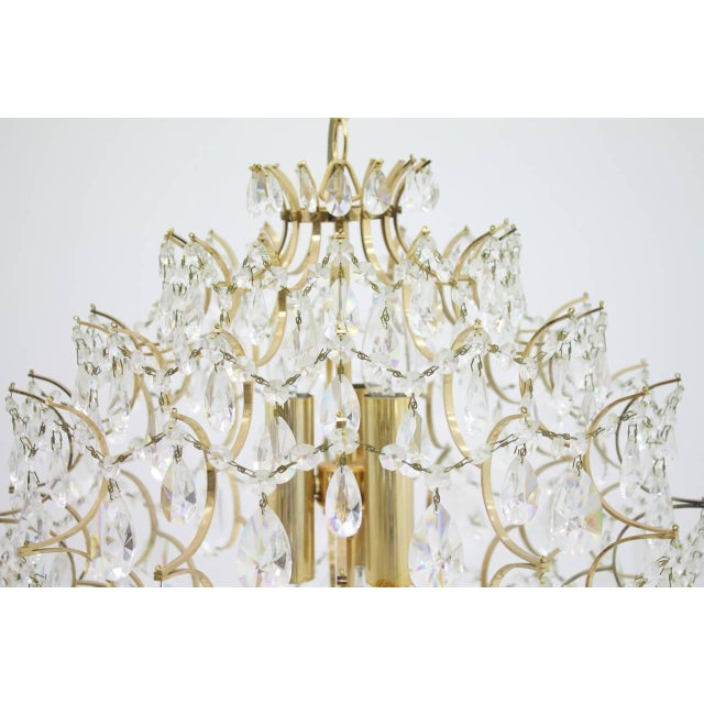 Great chandelier with Swarovski glass , 1970s. Crystal Glass and gilded frame. Very good condition.