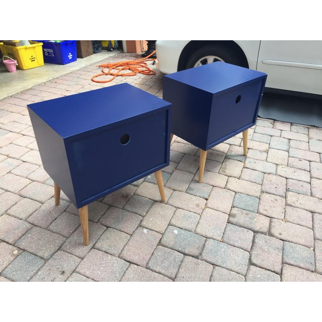 Pair of beautiful blue modern night stand /tables with wood tapered legs. single draw with storage