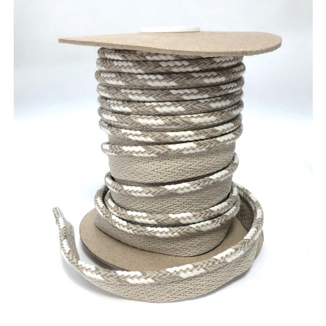 """One 10 yard spool of 1/4"""" braided cord with flange Cording color: stark white and beige/sand mingle. Flange is 1/2"""" wide..."""