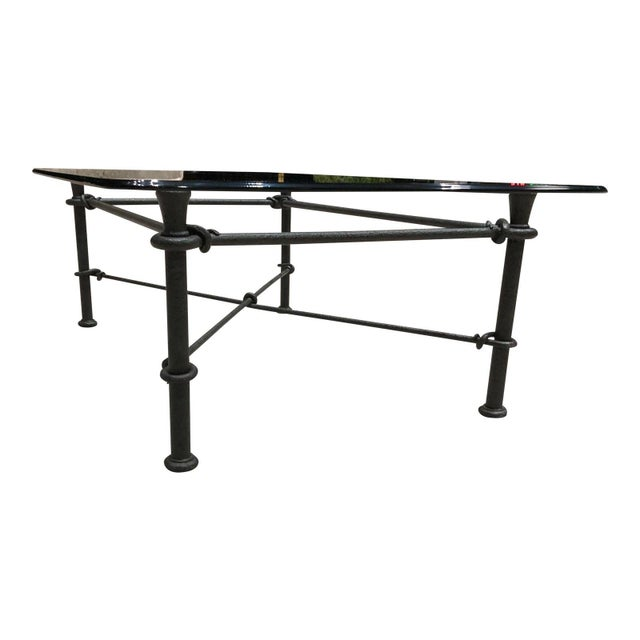 Modern rectangular wrought iron based coffee table. Giacometti style, with heavy beveled glass top.